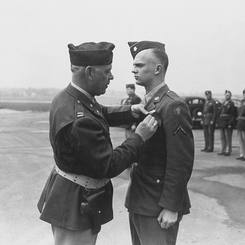 Ben R. Wetenhall Sr. presents the Silver Star, awarded for gallantry in action, to his son, Ben R. Wetenhall Jr.