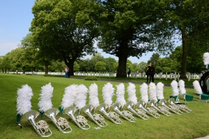 Baritone horns and marching band helmets at the Brittany American Cemetery in Normandy, France.
